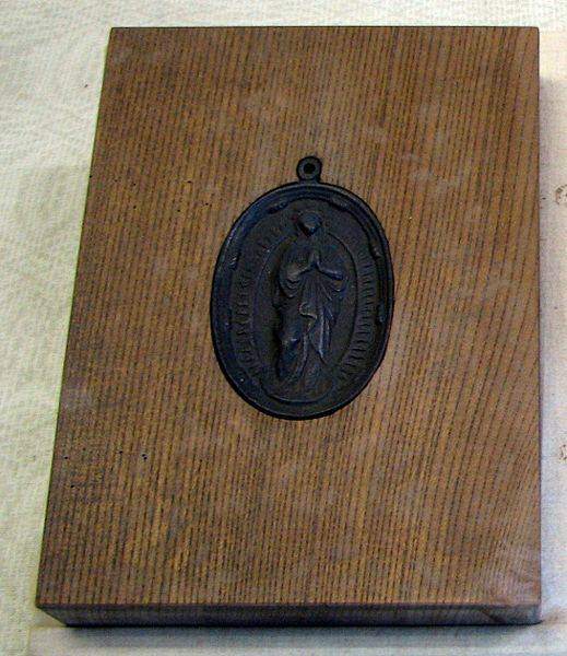 Image:Virgin Mary tile to step on.jpg